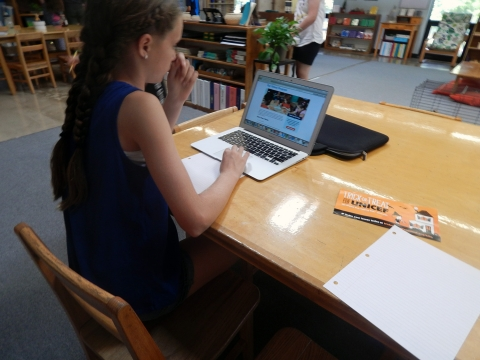 Upper Elementary student doing research on a Chromebook